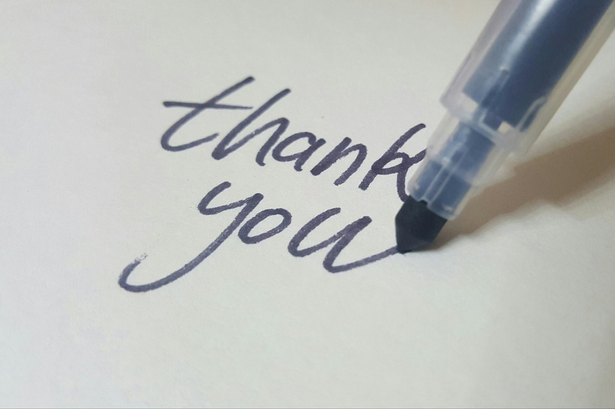 Felt tip marker writing thank you on paper
